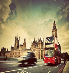 London, the UK. Red bus, taxi cab in motion and Big Ben, the Palace of Westminster. The icons of England in vintage, retro style